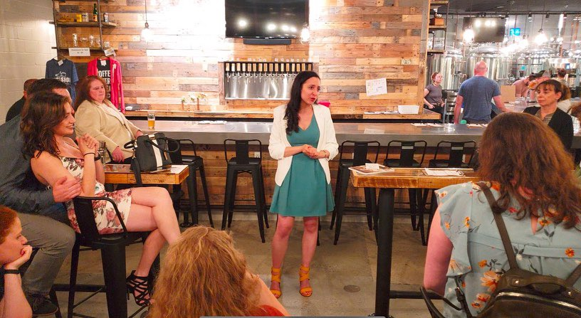 Former fellow Samantha talking to constituents in a restaurant