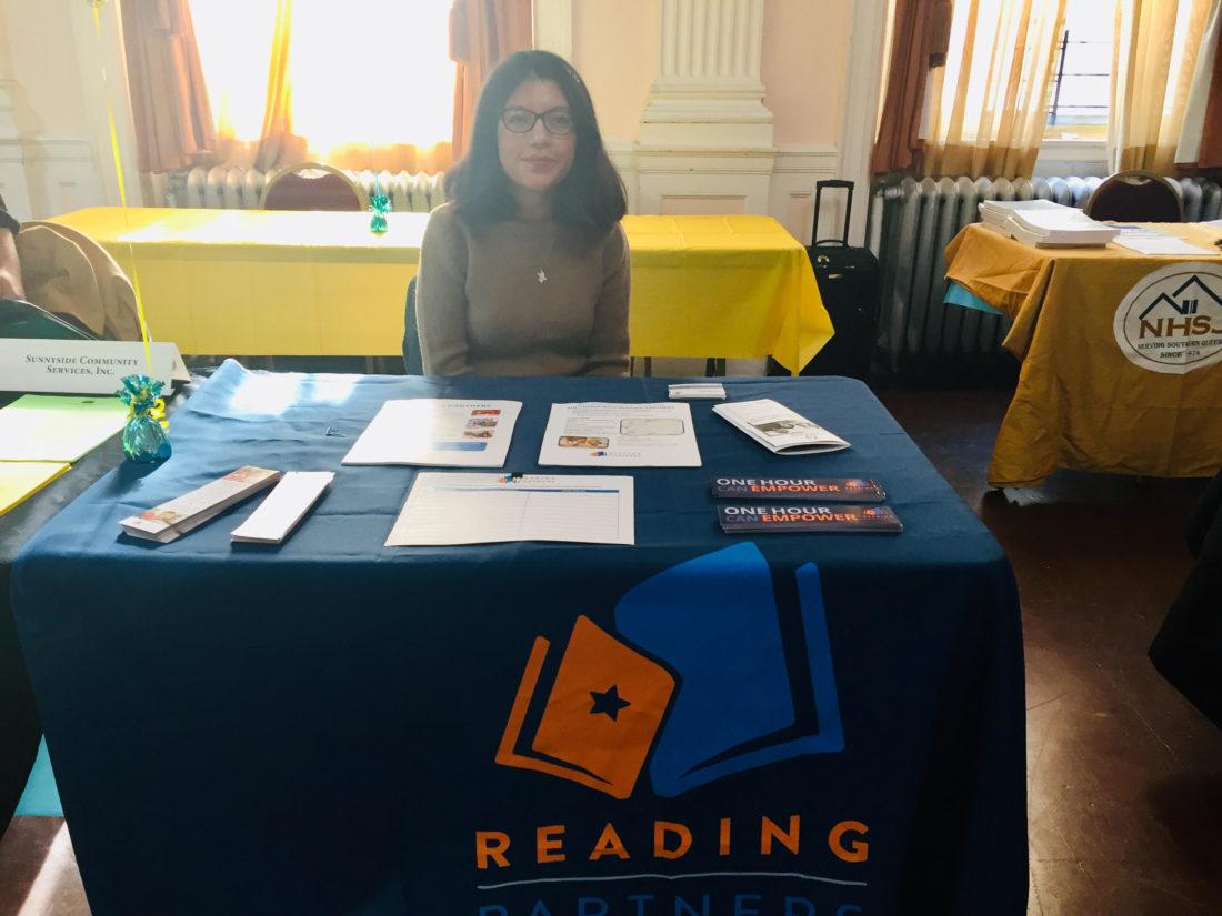 Former fellow Erika tabling for Reading Partners