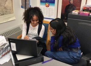 A Breakthrough Boston student peer mentoring another student