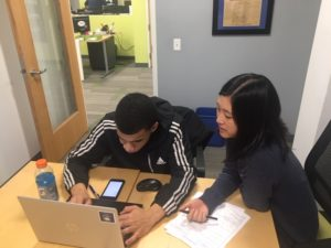 Former fellow Joyce Kim advising a student one on one