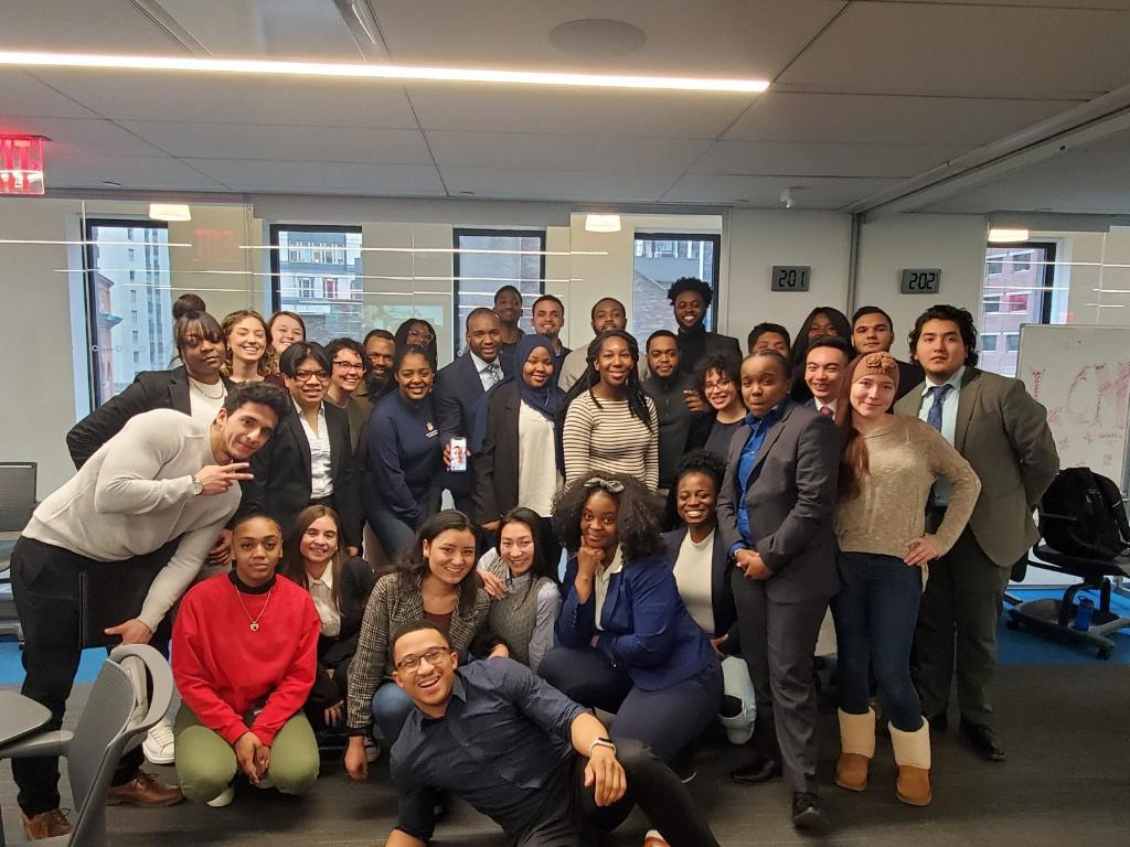 Former fellow Emily posing with members of the Yearup community