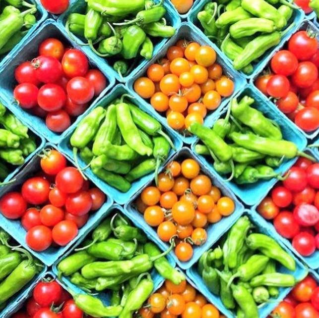 Cartons of brightly colored vegetables